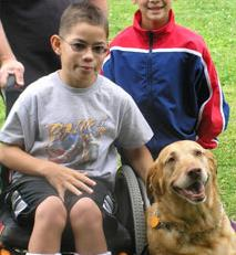 Child in wheelchair with dog
