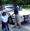 Citizen Police Academy for Youth female officer working with 2 young ladies